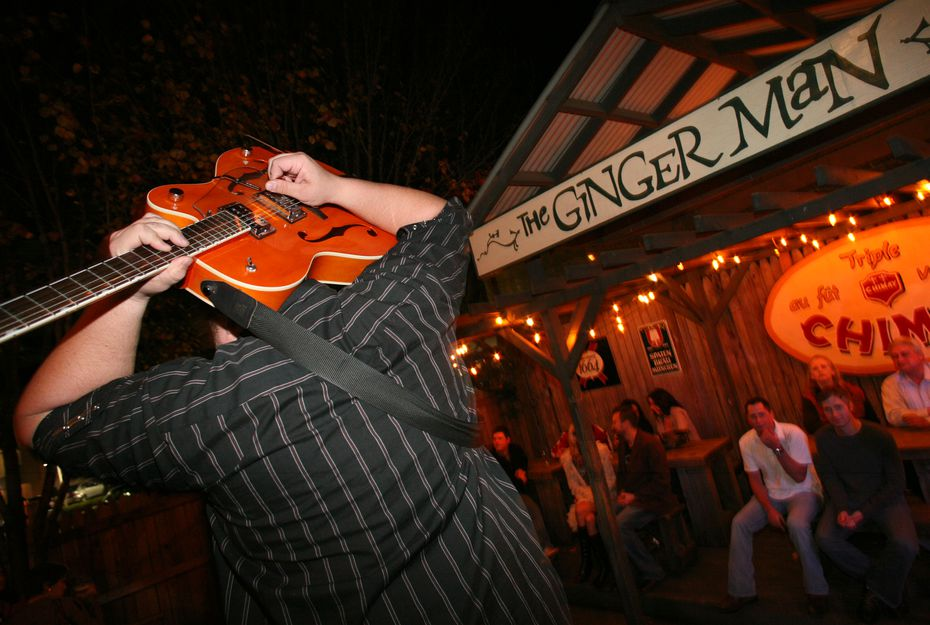 In this 2008 file photo, Robbie Clements plays his guitar behind his head in the backyard of The Ginger Man in Dallas.