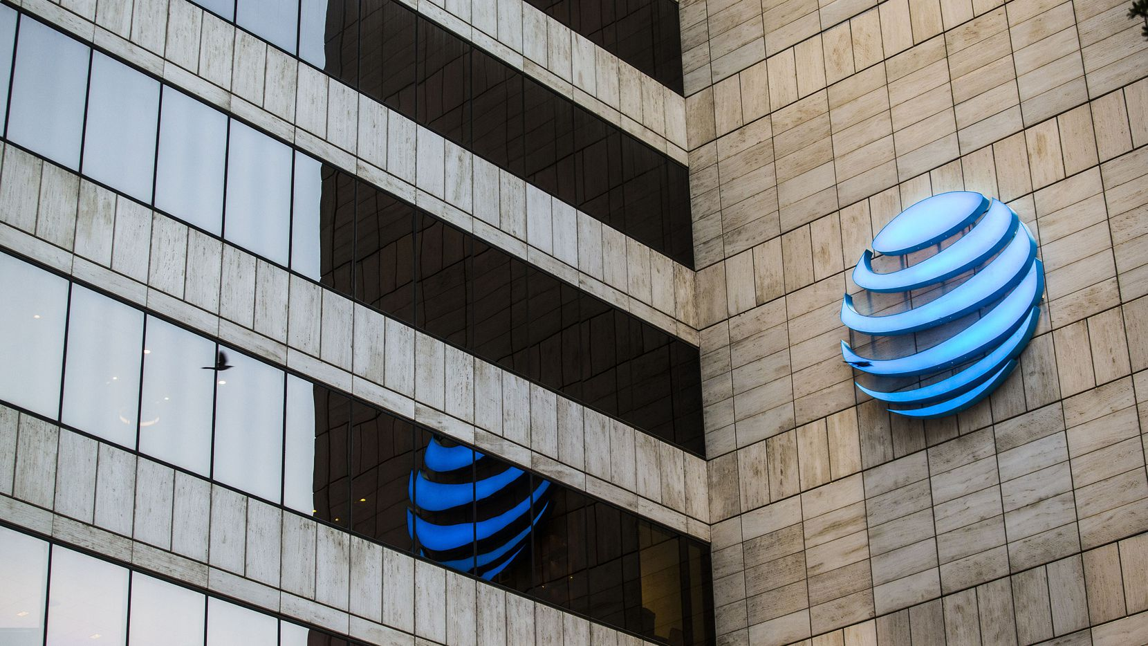 Executives at AT&T, whose headquarters is in downtown Dallas, helped push for corporate tax cuts in 2017 and were among the companies handing out $1,000 bonuses to employees. (Carly Geraci/The Dallas Morning News/TNS)