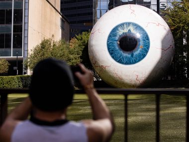 "Artist Tony Tasset's giant eyeball sculpture, ""Eye,"" has been a popular attraction in Dallas since its debut in 2013. It was damaged on the night of May 29, when protesters tagged it with graffiti in the wake of George Floyd's death at the hands of Minneapolis police."