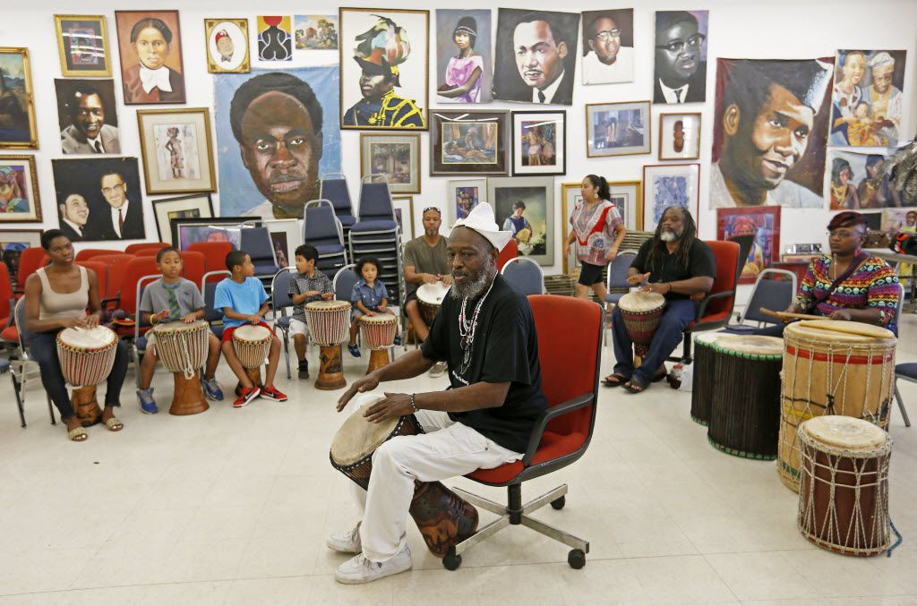 Community leader Baba Ifayomi Amuson (center) teaches how to play drums during a Community Sunday Drum Circle at the Pan African Connection Bookstore, Art Gallery and Resource Center in Dallas, Sunday, July 10, 2016. (Jae S. Lee/The Dallas Morning News)