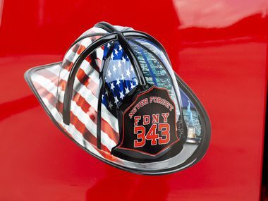 A decal on the vehicle of Grapevine Fire Assistant Chief Stuart Grant is a memorial to those who died during the Sept. 11 attacks photographed at the Grapevine Public Safety Building on Friday, Aug. 27, 2021, in Grapevine, Texas. The number 343 represents the number of New York City Fire Fighters who died during the Sept. 11 attacks.