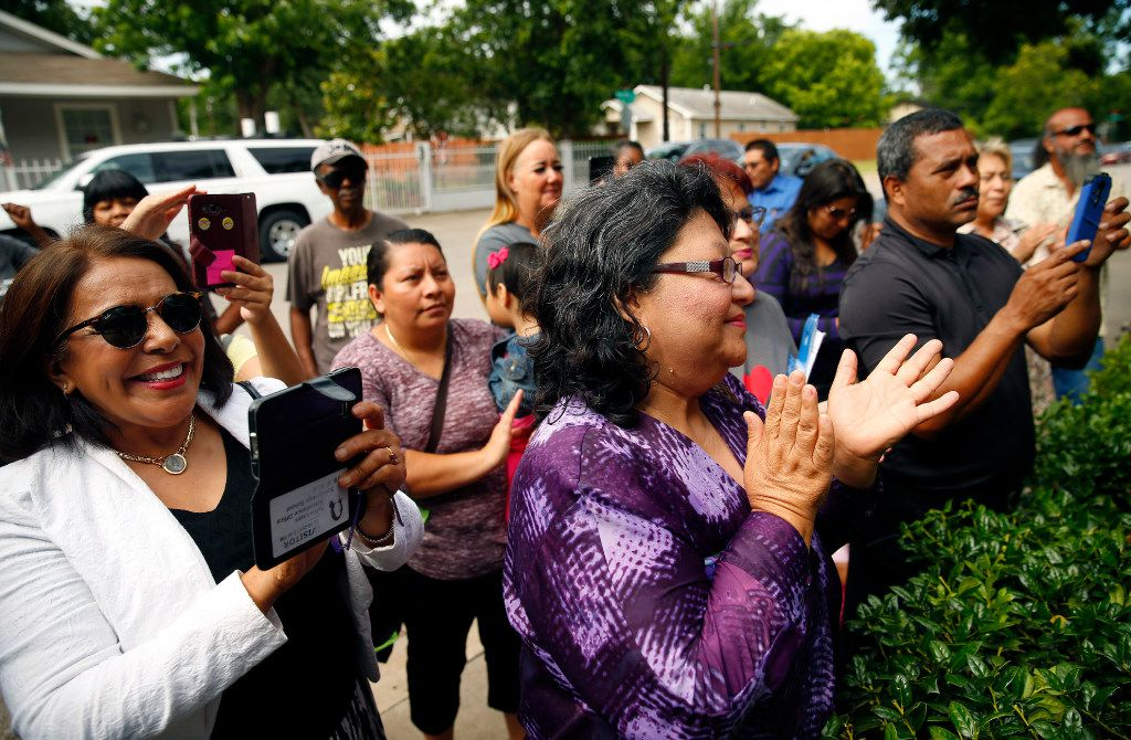 Neighborhood residents applaud HMK landlord Khraish Khraish for changing his mind, deciding to sell homes to their West Dallas tenants for $65,000 during a press conference, Monday, May 22, 2017. The change he says has comes at the convincing of LULAC's Hilda Duarte, Ronnie Mestas, president of West Dallas 1 neighborhood coalition, and Dallas City Council District 6 candidate Omar Narvaez.  (Tom Fox/The Dallas Morning News)