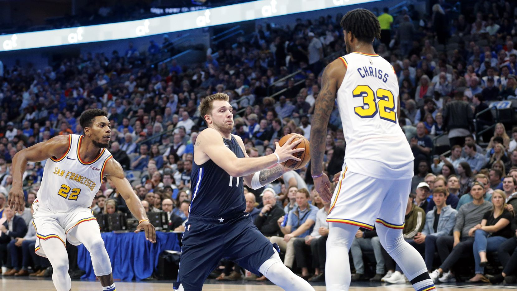Dallas Mavericks forward Luka Doncic (77) makes a move on Golden State Warriors forward Marquese Chriss (32) for a second quarter layup at the American Airlines Center in Dallas, Wednesday, November 20, 2019. (Tom Fox/The Dallas Morning News)