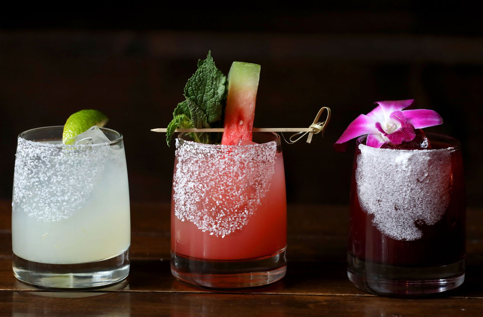 From left, the classic margarita, the Machete, and the hibiscus margarita at Mexican Sugar in Plano. (2019 File Photo)