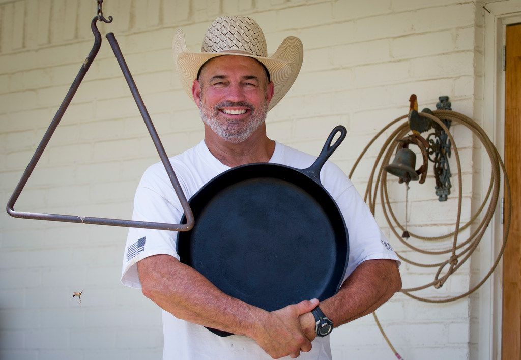 Mike Newton, known as the Cowboy Chef, holds one of his favorite cast-iron skillets on the back porch of his ranch house in Lipan, Texas on July 17, 2018. (Robert W. Hart/Special Contributor)