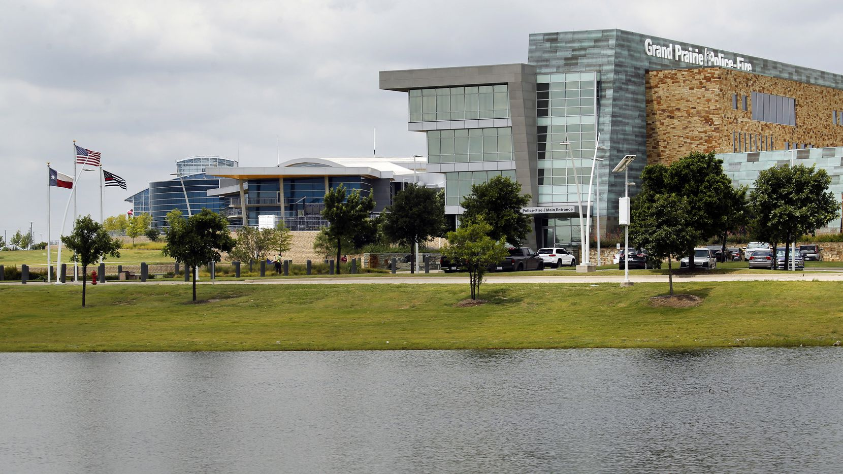 The Grand Prairie Police and Fire Departments administration building (right), The Epic (middle) and Epic Waters (left) are seen in the Epic Central park development along SH 161 in Grand Prairie, Texas, on June 25, 2020. Grand Prairie police will host a free party Saturday at Epic Lawn with live music, a petting zoo and a bicycle rodeo.