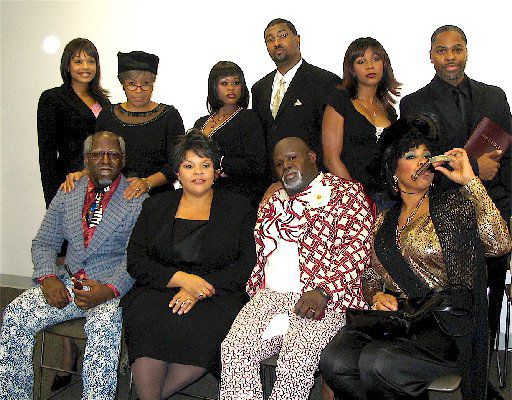 Front row, second from the left is Tamela Mann who stars as Cora and next to her is David Mann, who stars as Mr. Brown.