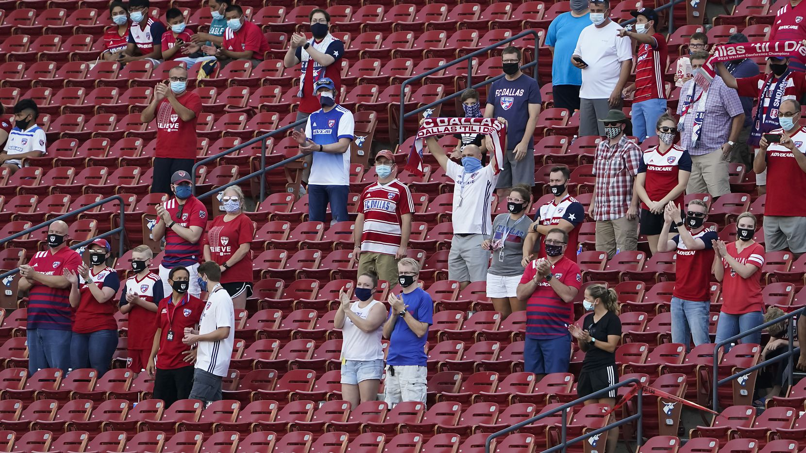 FC Dallas supporters cheer as their team takes the field before an MLS soccer game against the Nashville SC at Toyota Stadium on Wednesday, Aug. 12, 2020, in Frisco, Texas.
