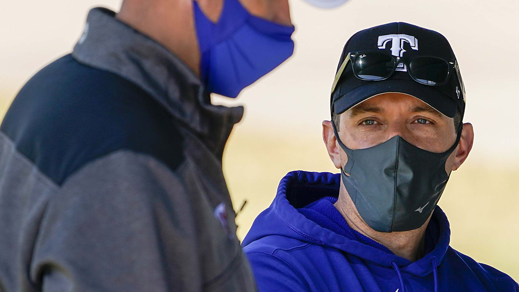 Texas Rangers president, baseball operations, Jon Daniels (right) and executive vice president & general manager Chris Young watch during a spring training workout at the team's training facility on Saturday, March 6, 2021, in Surprise, Ariz.