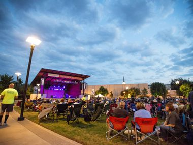 This 2014 file photo shows a crowd gathered for a concert at Arlington's Levitt Pavilion. Gone silent during the pandemic, the entertainment venue has partnered with UT Arlington for a virtual series discussing music and hosting guitar lessons.