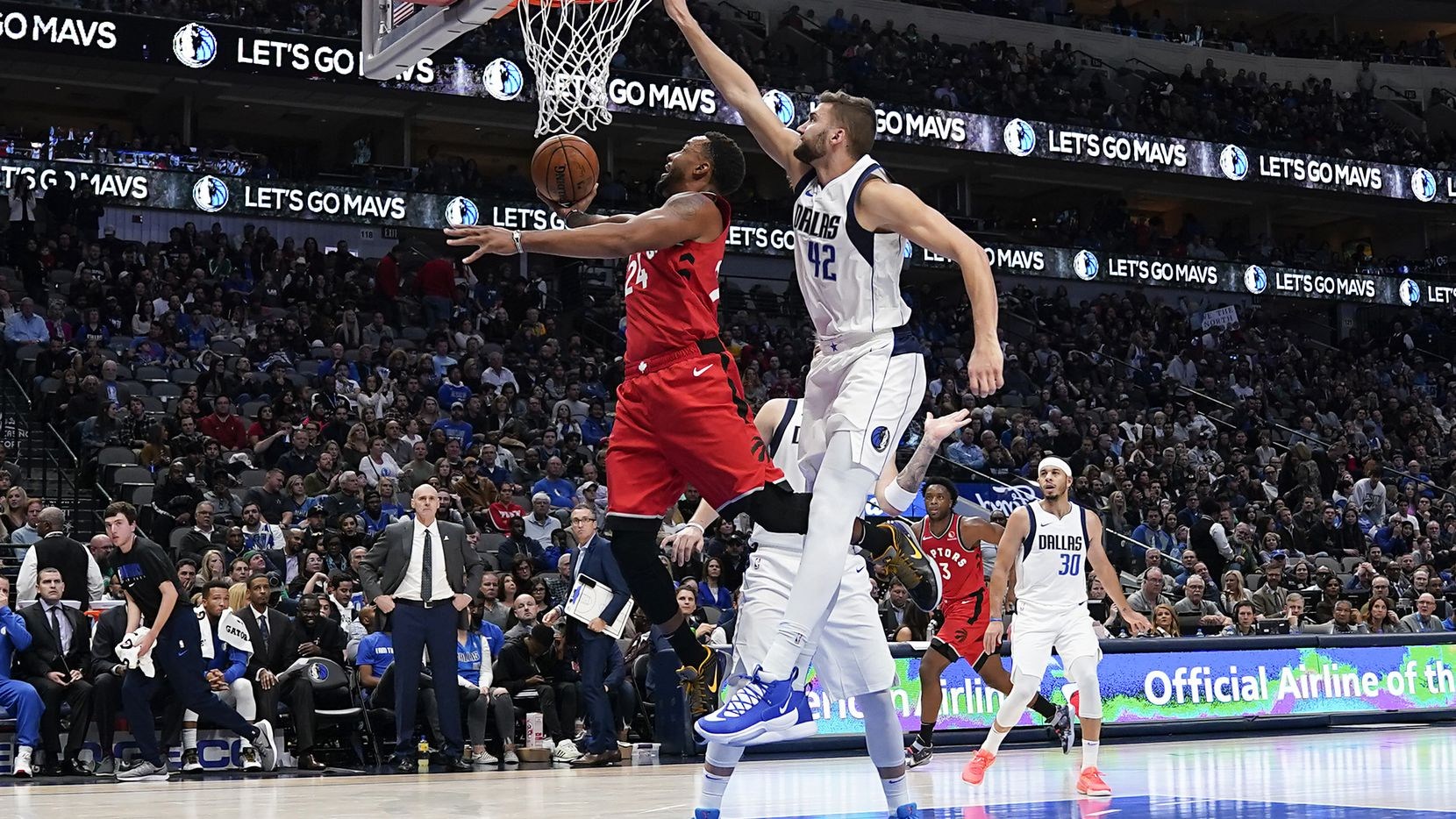 Toronto Raptors guard Norman Powell (24) drives to the basket past Dallas Mavericks center Maxi Kleber (42) during the second half of an NBA basketball game at American Airlines Center on Saturday, Nov. 16, 2019, in Dallas.