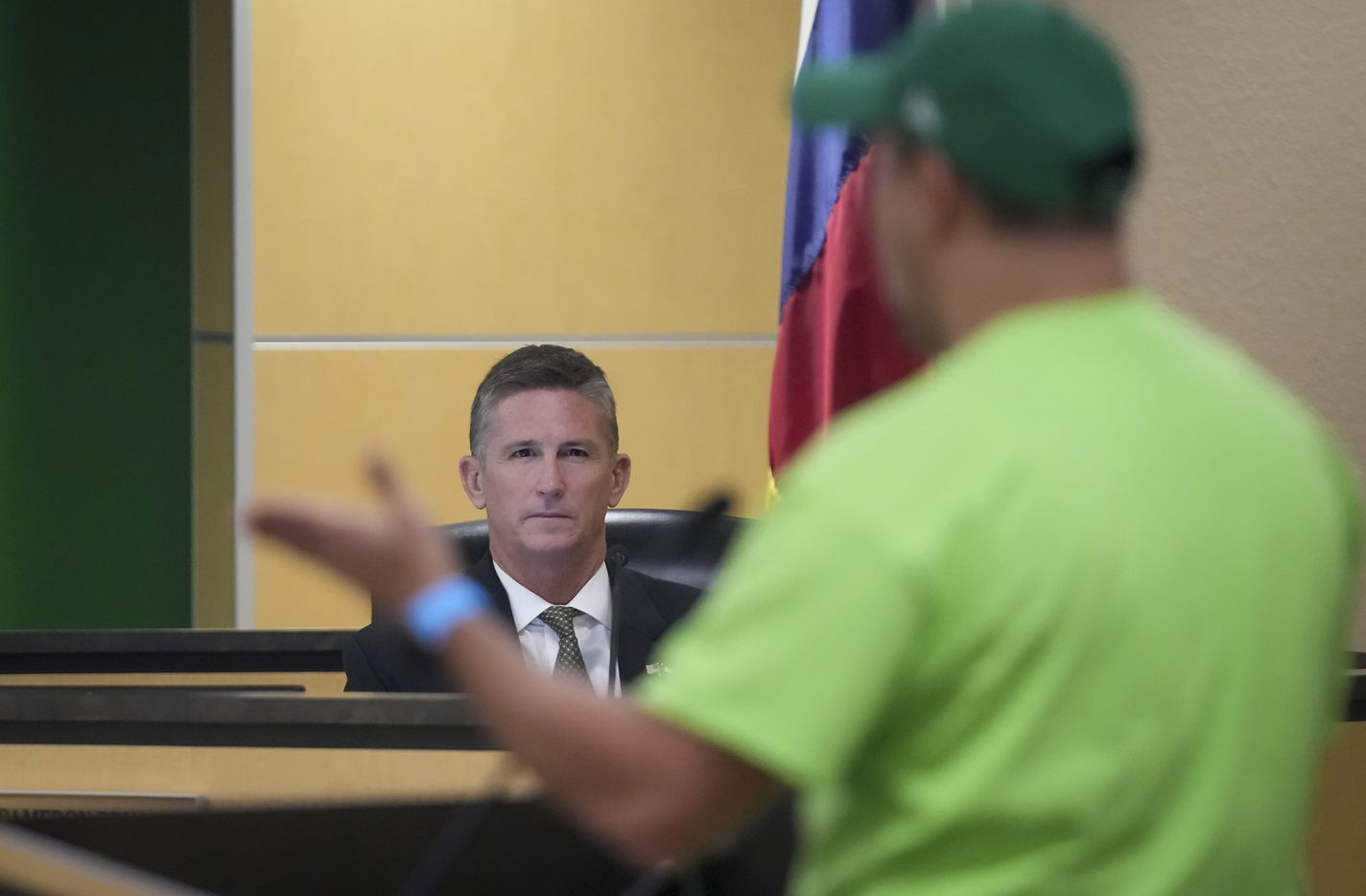 Trustee Cam Bryan listens to a speaker opposed to mask mandates during public comment at the Carroll ISD school board meeting on Monday, Aug. 23, 2021, in Southlake, Texas. (Smiley N. Pool/The Dallas Morning News)