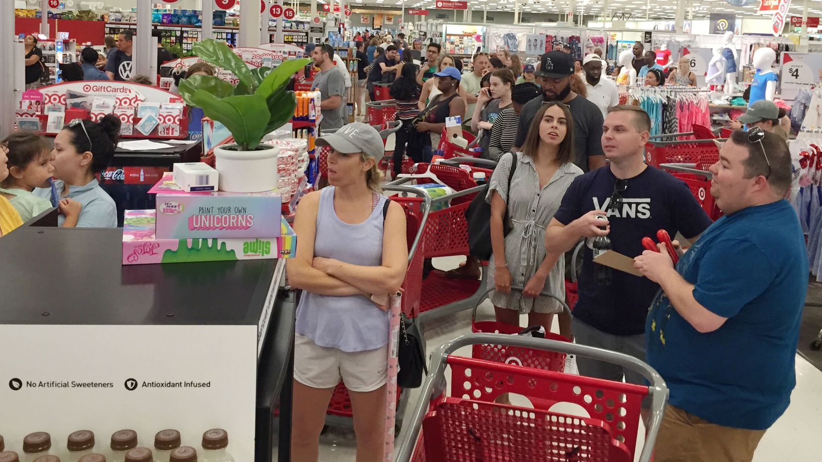 Target customers stand in long lines at the store on North Haskell Ave on Saturday afternoon June 15, 2019 in Dallas, Texas.  A system glitch at Target stores nationwide has clogged checkout aisles.(Irwin Thompson/The Dallas Morning News)