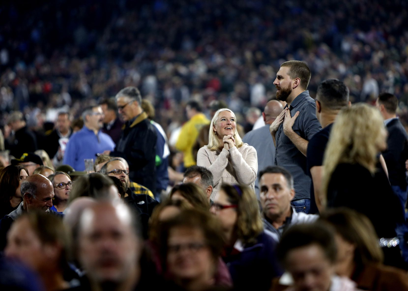 Prior to Billy Joel hitting the stage, fans socialize among a capacity crowd. Billy Joel performed to the delight of fans at Globe Life Park in Arlington on Oct. 12, 2019.