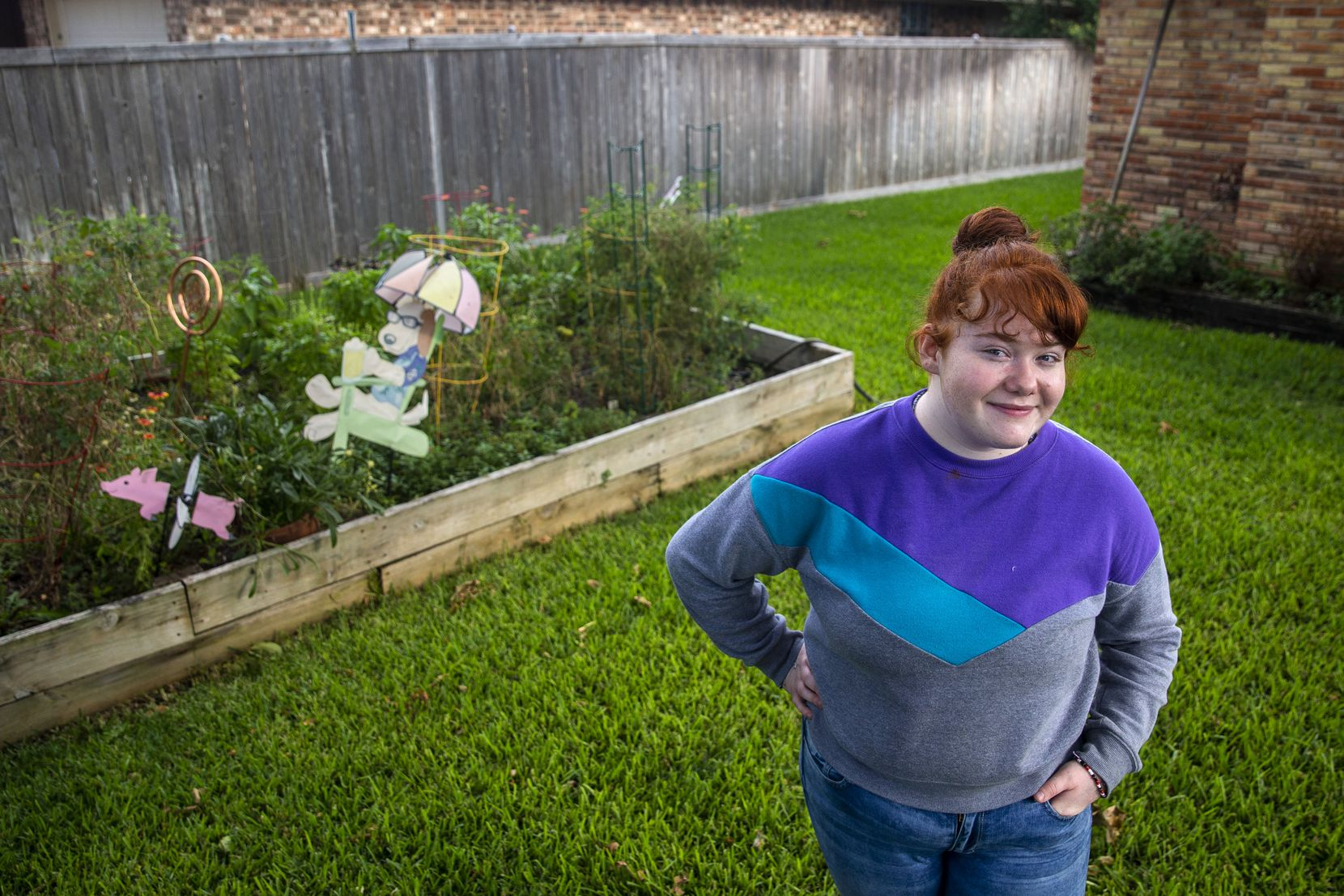 """Abbigale Phillips, in the backyard of her legal guardian and aunt, Molly Baldwin, in Richardson. Abbigale considers this """"my second home"""" where her dog, Sunshine, stays. Abbigale lives in Sachse with her grandparents so that she can attend high school there."""