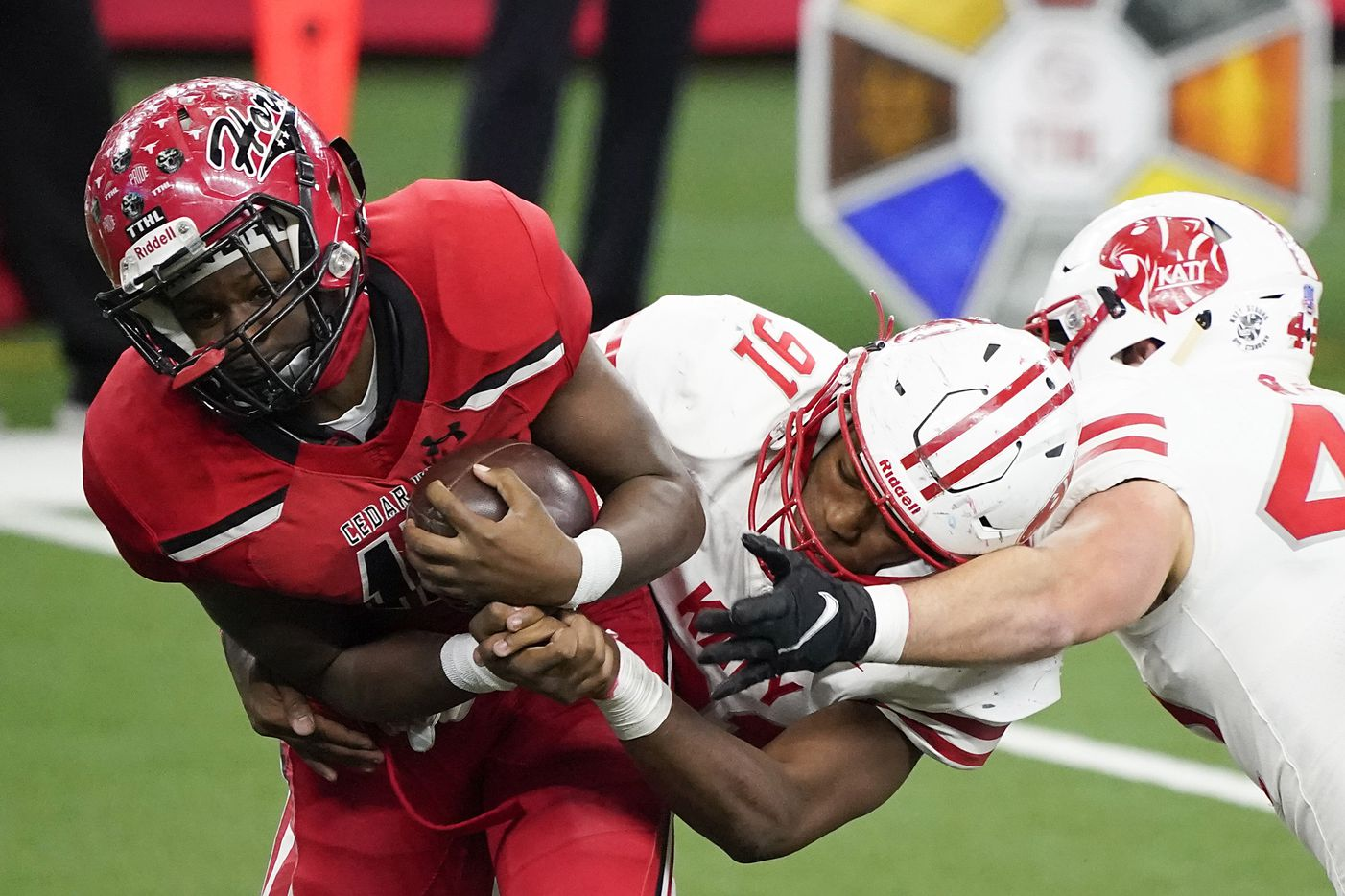 Cedar Hill wide receiver Dewayne Blanton (15) is wrapped up by Katy defensive lineman Cal Varner (91) during the second half of the Class 6A Division II state football championship game at AT&T Stadium on Saturday, Jan. 16, 2021, in Arlington, Texas. Katy won the game 51-14.