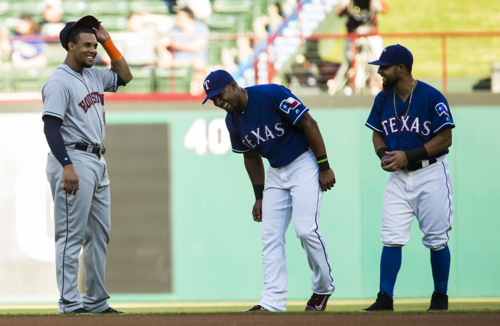 Texas Rangers shortstop Elvis Andrus (1) and second baseman Rougned Odor (12) share a laugh with Houston Astros center fielder Carlos Gomez (30) before their game on Tuesday, June 7, 2016 at Globe Life Park in Arlington, Texas.  (Ashley Landis/The Dallas Morning News)