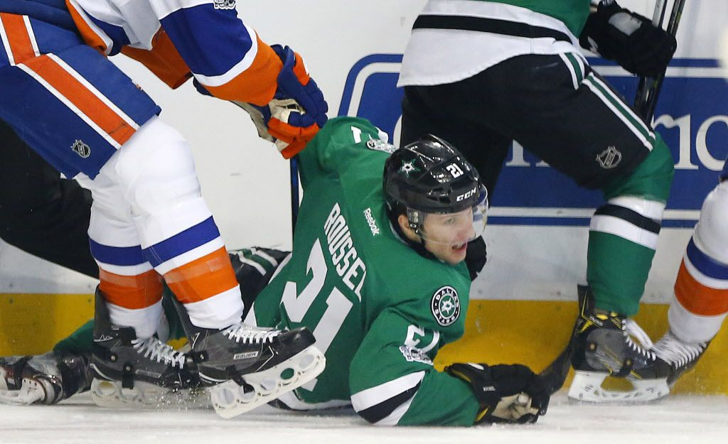 Dallas Stars left wing Antoine Roussel (21) is pushed down during the first period by New York Islanders at the American Airlines Center in Dallas, Thursday, March 2, 2017. Later in the period, Roussel suffered a possible season ending injury.  (Tom Fox/The Dallas Morning News)