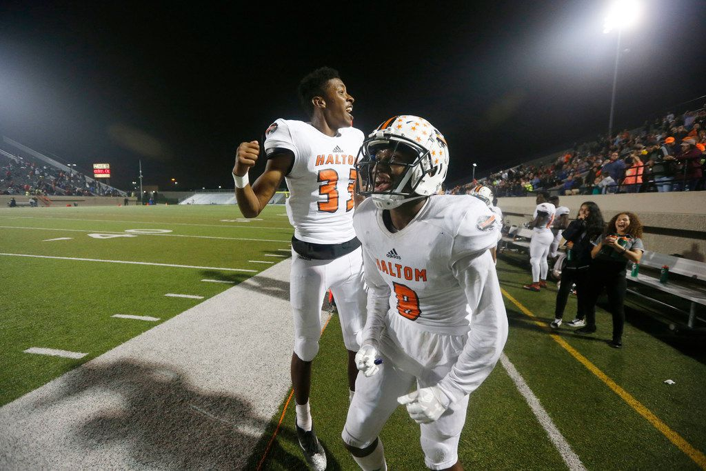 Haltom players Davion McCoy (33) and Juian Johnson (8) react to a tackle against Trinity during the second half of their high school football game in Bedford, Tx, on October 12, 2018.  Haltom won the game 48-34.(Michael Ainsworth/Special Contributor)