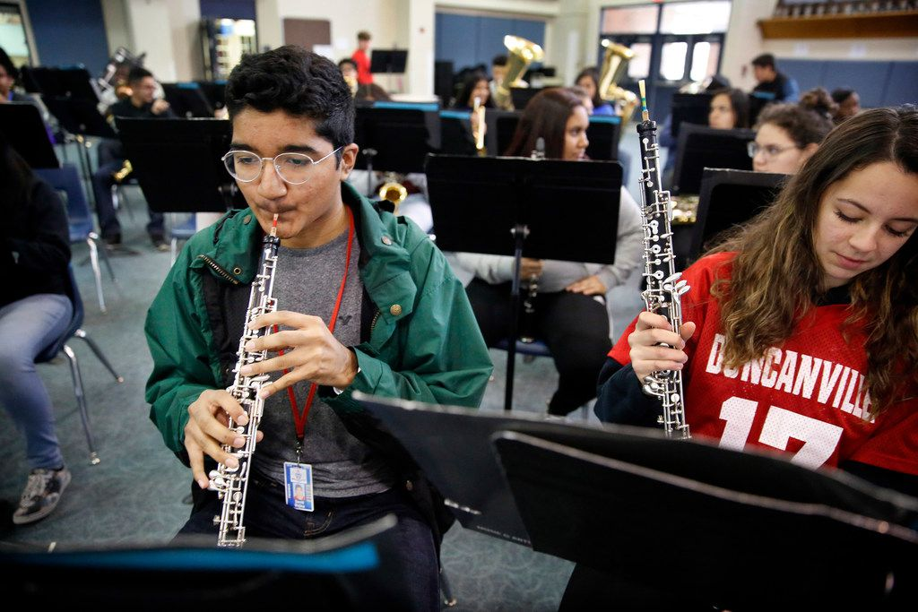 Freshman oboe player David Mojica (left) warms up on his instrument alongside classmate Kelly Valencia in concert band at Duncanville High School on Jan. 31, 2019. Mojica suffers from aplastic anemia, a blood disease that could require a bone marrow transplant from the right donor. For Latino patients, like David,  there is a desperate need to find bone marrow donors of Hispanic origin.