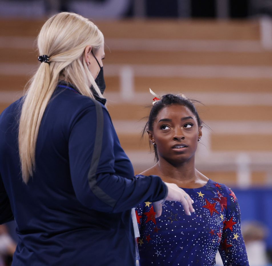 USA's Simone Biles gets instruction from her coach Cecile Landi before competing in a women's gymnastics event during the postponed 2020 Tokyo Olympics at Ariake Gymnastics Centre on Sunday, July 25, 2021, in Tokyo, Japan. (Vernon Bryant/The Dallas Morning News)