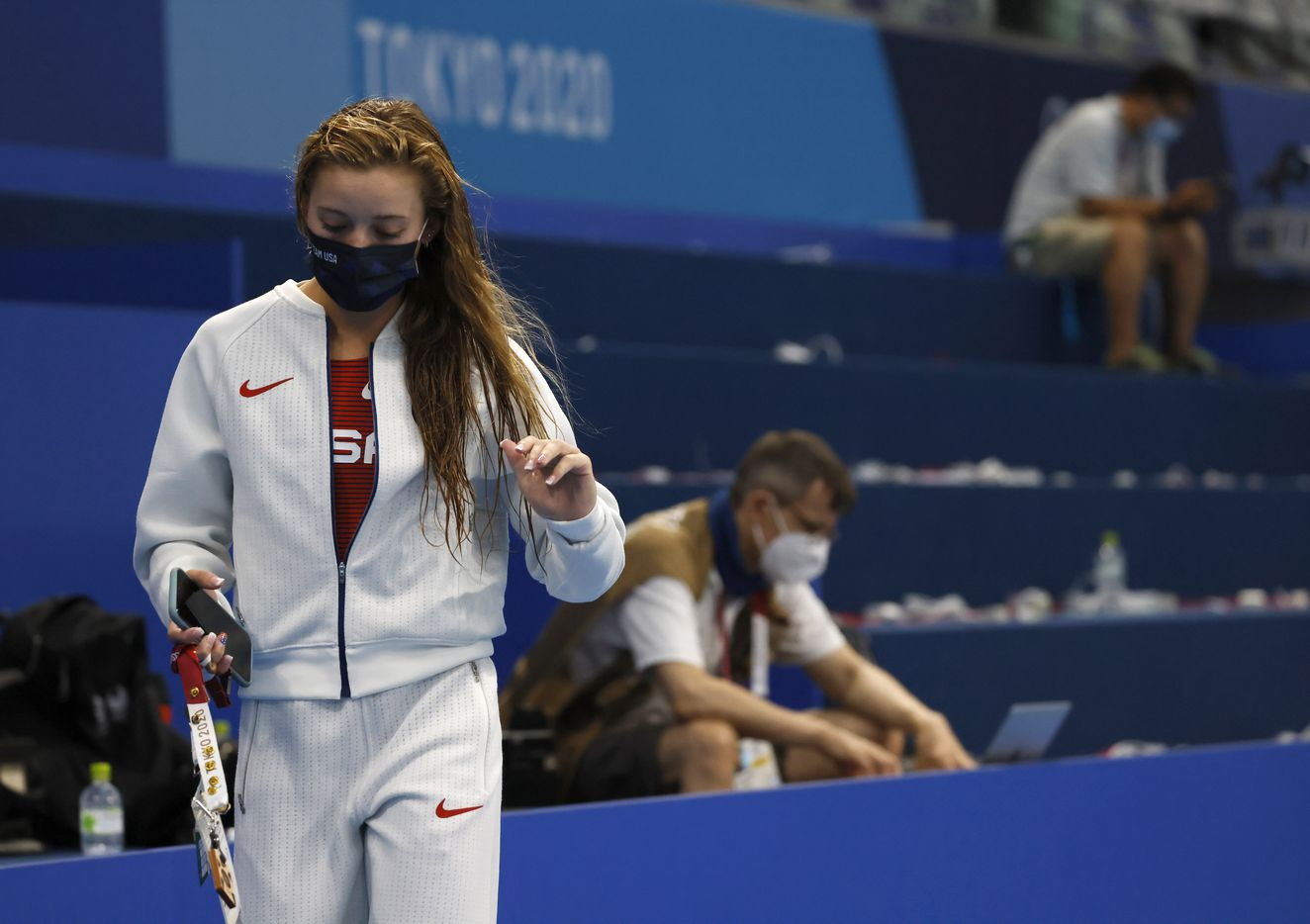 USA's Hailey Hernandez makes her way towards coaches after finishing up with interviews with the media after competing in the women's 3 meter springboard final during the postponed 2020 Tokyo Olympics at Tokyo Aquatics Centre, on Sunday, August 1, 2021, in Tokyo, Japan. (Vernon Bryant/The Dallas Morning News)