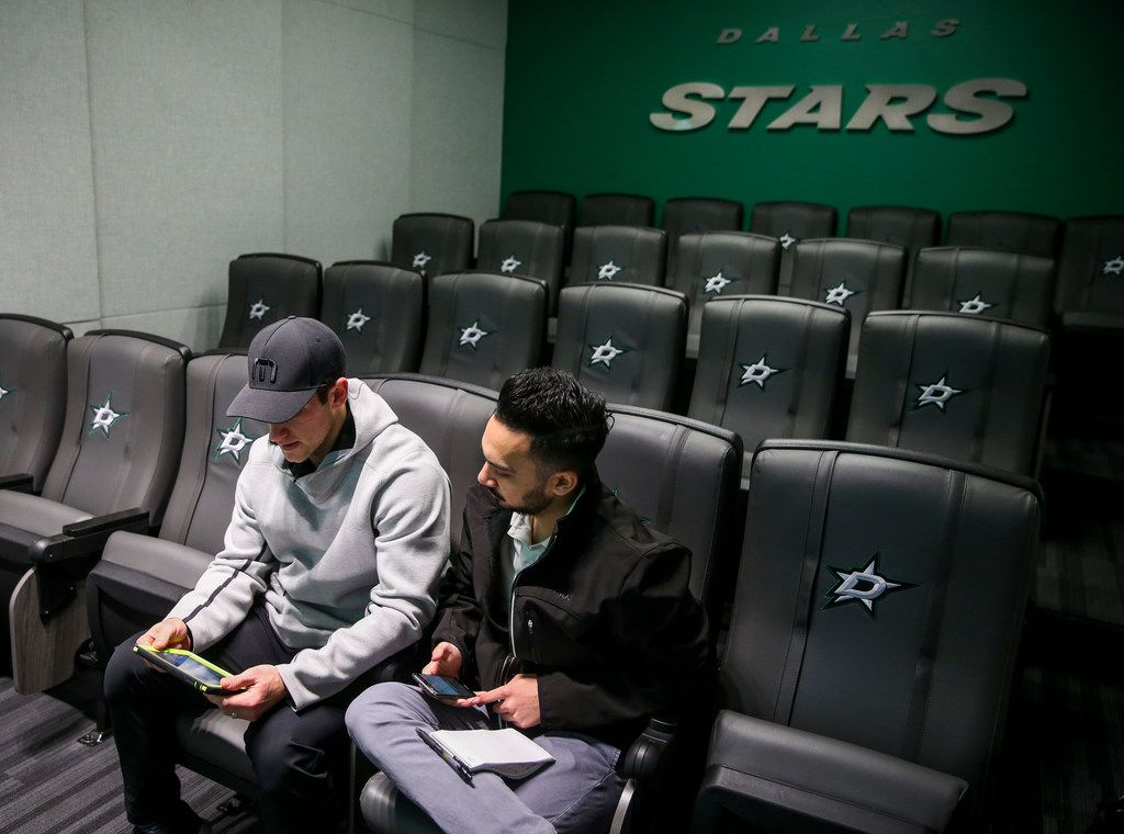 Dallas Stars defender Taylor Fedun, left, goes over film with The Dallas Morning News writer Matt DeFranks, right,following practice at Comerica Center in Frisco, Texas on Friday, Feb. 22, 2019. (ShabanAthuman/The Dallas Morning News)
