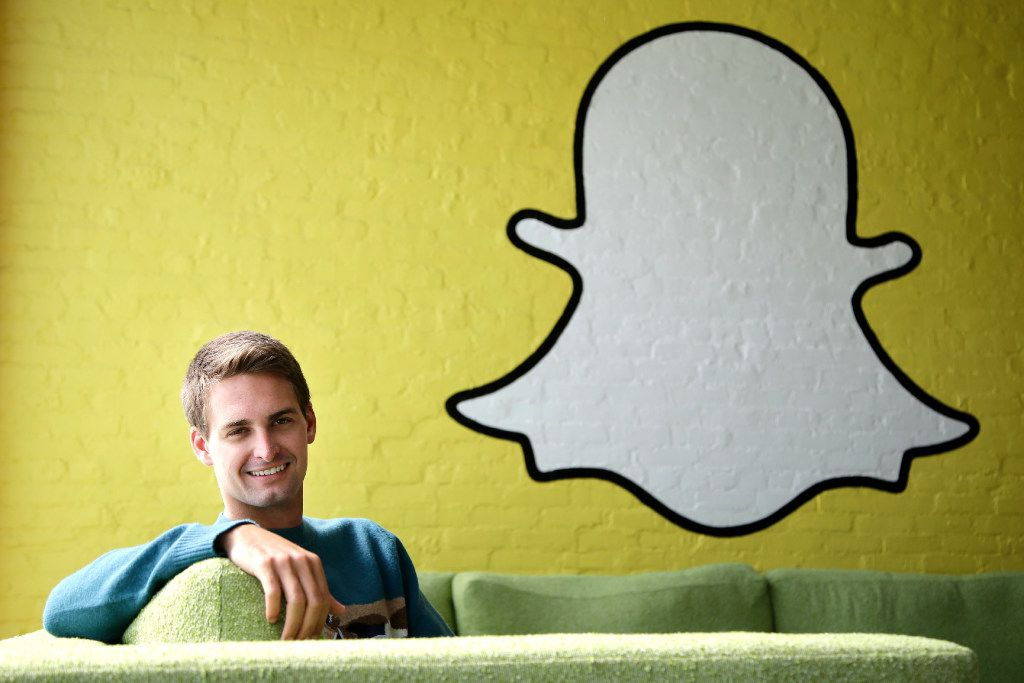 FILE - In this Thursday, Oct. 24, 2013, file photo, Snapchat CEO Evan Spiegel poses for a photo in Los Angeles. Snap Inc. is listing the company's valuation at up to $22 billion as it prepares for the tech industry's biggest initial public offering in years. The parent company of SnapChat said in a regulatory filing Thursday, Feb. 16, 2017, that the IPO is likely to be priced between $14 and $16 per share. (AP Photo/Jae C. Hong, File)