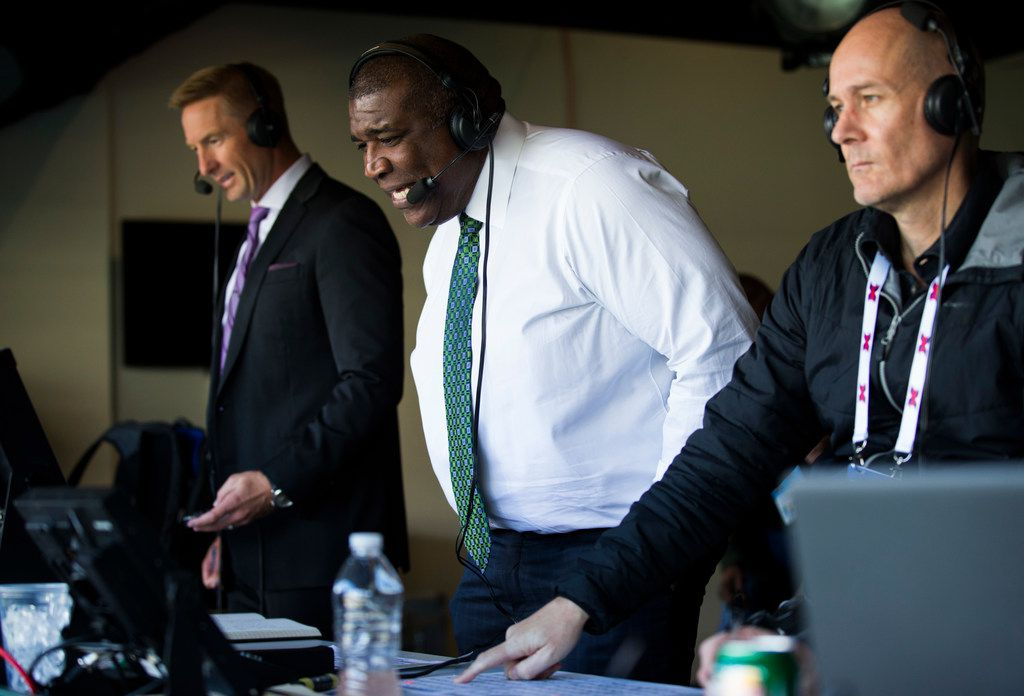 FOX Sports broadcasters Joel Klatt (left) and Curt Menefee (center) call an XFL game between the Dallas Renegades and the New York Guardians on Saturday, March 7, 2020 at Globe Life Park in Arlington. (Ashley Landis/The Dallas Morning News)