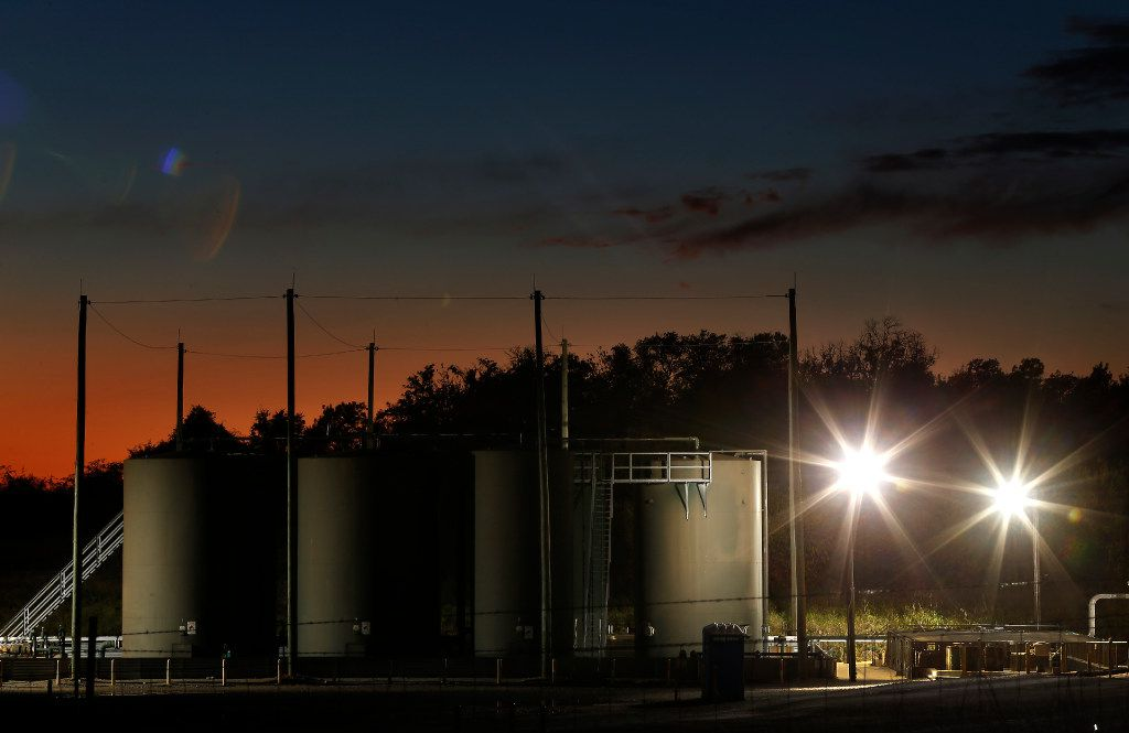 The sun sets behind a wastewater disposal well just outside the city limits of Reno, Texas. In 2015, scientists tied earthquakes in Reno and neighboring Azle to the disposal of wastewater from oil and gas operations. (Jae S. Lee/The Dallas Morning News)
