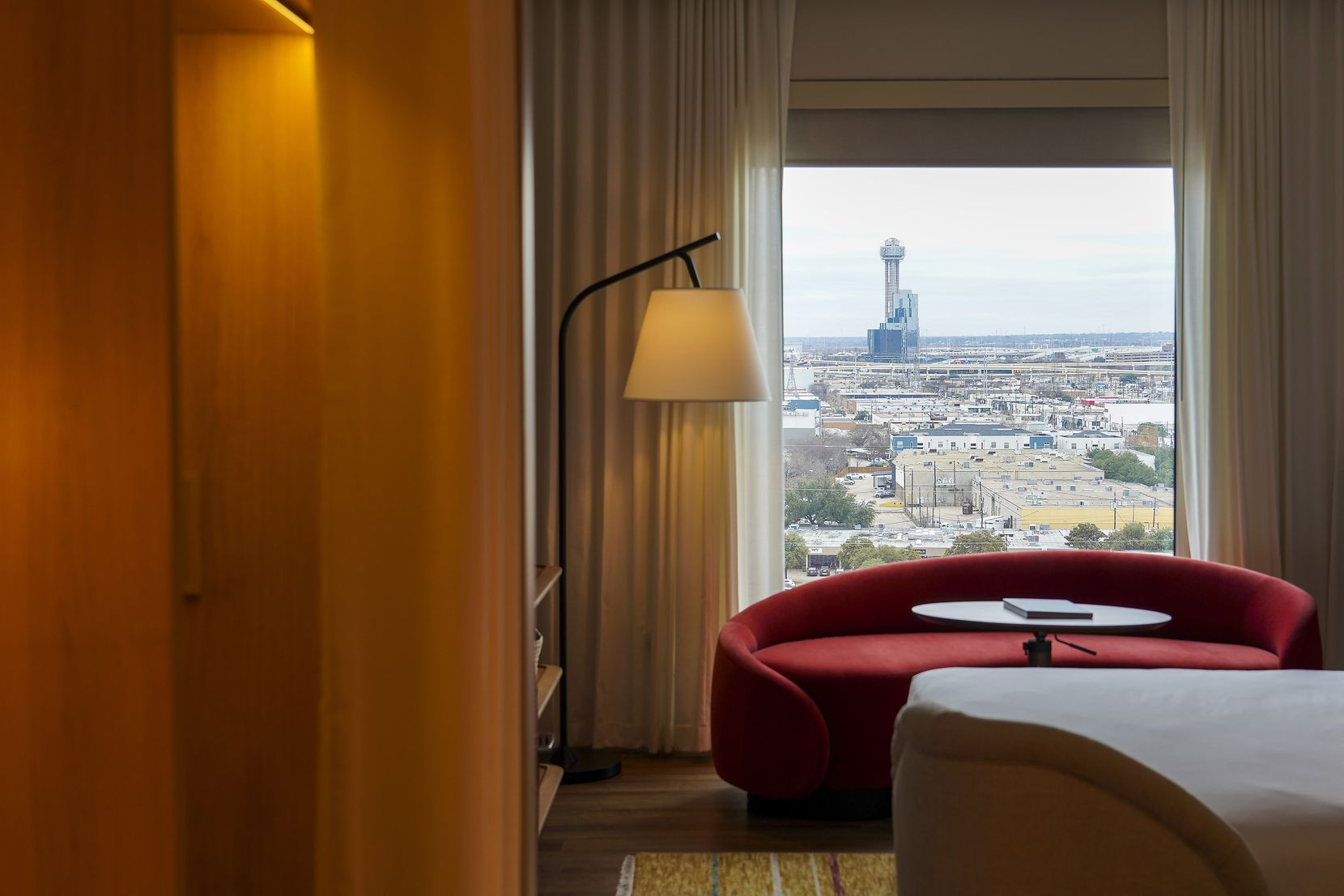 "Hotel rooms at the Virgin Hotels Dallas range in size from 323 to 1,395 square feet. Here, Reunion Tower is seen through the windows of a standard ""chamber"" at the new Design District hotel."