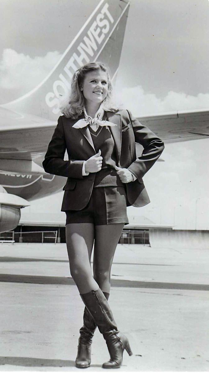 A Southwest Airlines flight attendant models the iconic hot pants uniform that the crews used to wear.