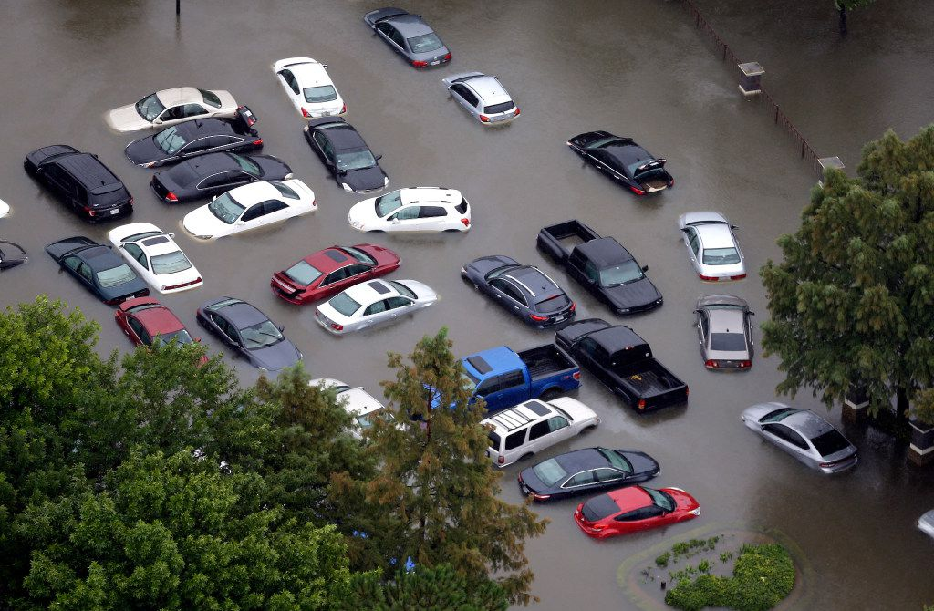 Flooded cars sit near the Addicks Reservoir in Houston after Harvey hit. (David J. Phillip/The Associated Press)