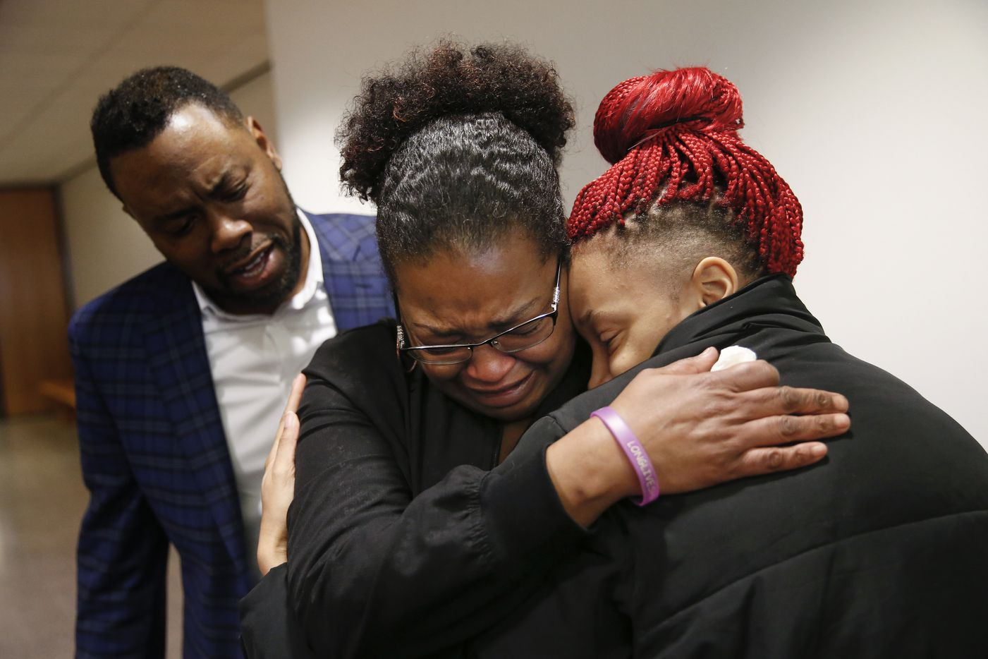 Shaquana Persley (center), mother of slain 13-year-old Shavon Randle, embraced daughter Shiniece Richards after Desmond Jones, one of the men implicated in the kidnapping and death of Randle, was sentenced Friday to 99 years in prison. (Ryan Michalesko/The Dallas Morning News)