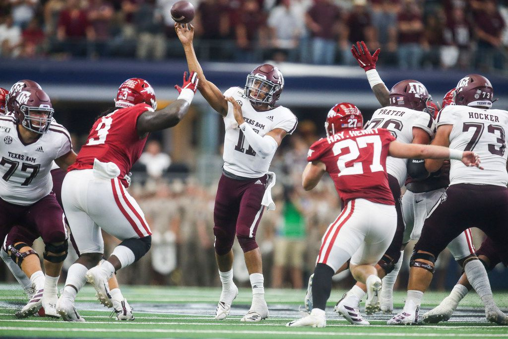 Texas A&M Aggies quarterback Kellen Mond (11) makes a pass to Quartney Davis for a touchdown during the first half of a NCAA football game between Texas A&M Aggies and Arkansas Razorbacks on Saturday, September 28, 2019 at AT&T Stadium in Arlington, Texas. (Shaban Athuman/Staff Photographer)