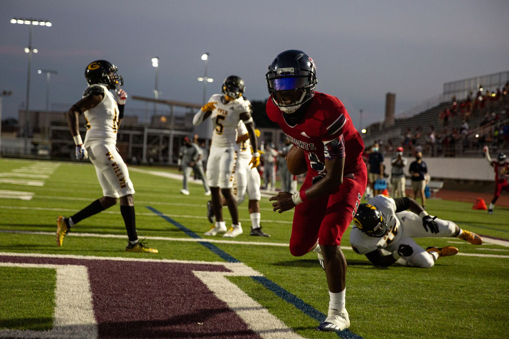 Justin F. Kimball High School's Jerqualan Parks (3) scores a touchdown a touchdown during the season-opening game against Garland High School at Sprague Stadium in Dallas, TX on August 27, 2021.   (Shelby Tauber/Special Contributor)