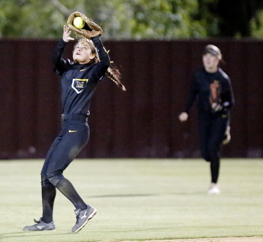 Memorial second baseman Ashley Camacho (2) makes a catch in shallow center field during the sixth inning as Heritage High School hosted Memorial High School for the District 9-5A softball championship in Frisco on Tuesday, April 20, 2021. (Stewart F. House/Special Contributor)
