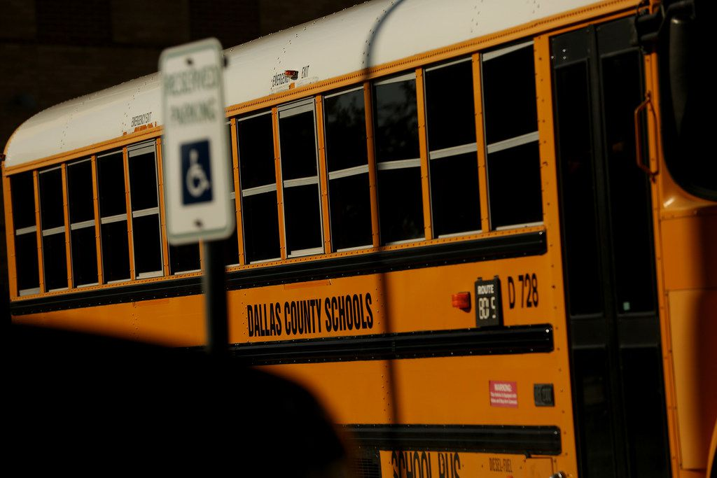 Students from J. J. Pearce High School ride on a Dallas County Schools bus following the school day in Richardson, Texas, Monday October 30, 2017. Texas state senator Don Huffines, R-Dallas, demanded Monday that three trustees immediately resign from the board of Dallas' embattled school bus service provider because he says they didn't stop questionable business deals and financial decisions.