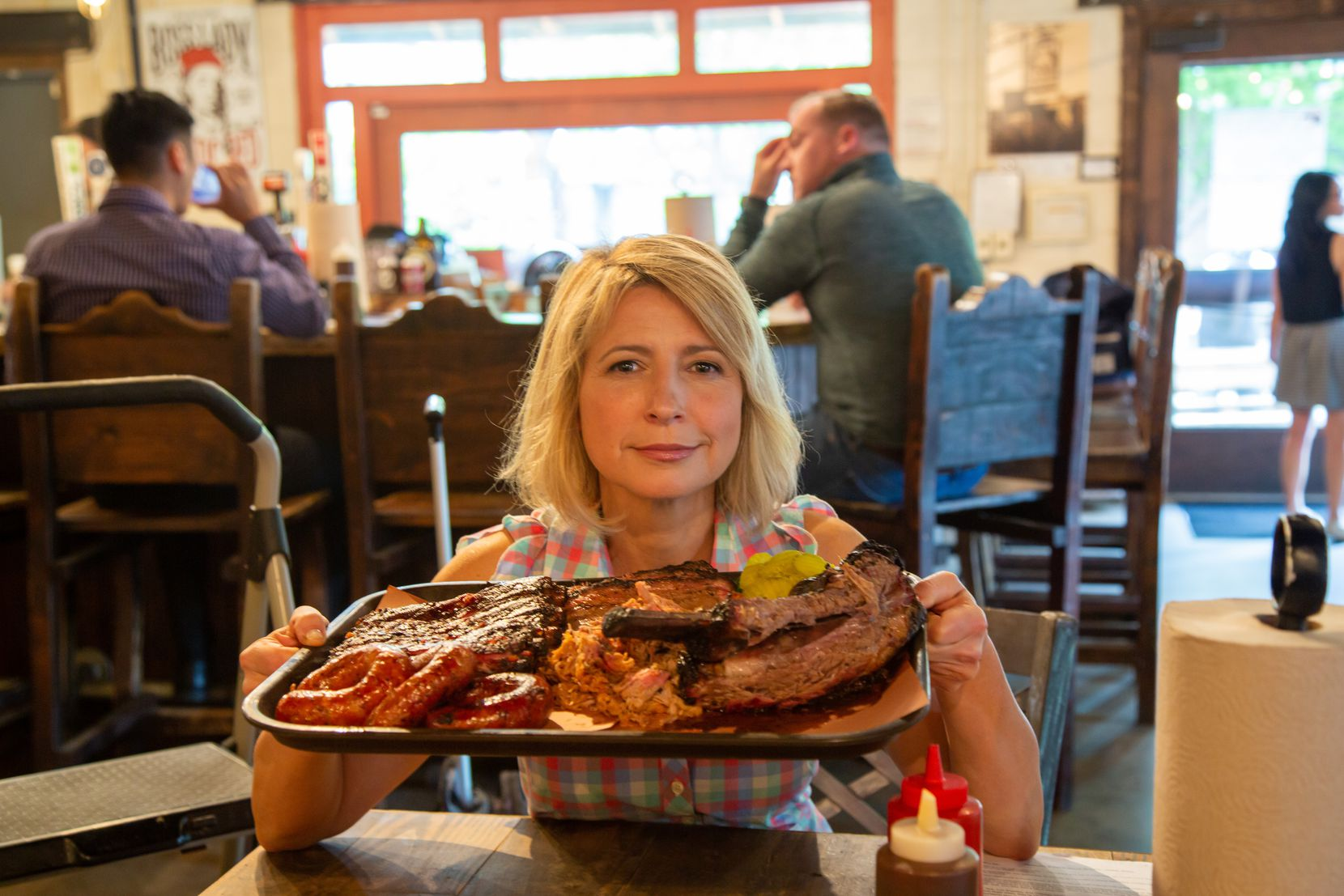 Television host Samantha Brown visits Pecan Lodge in Dallas as part of her PBS show 'Places to Love.'