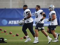 Dallas Cowboys offensive tackle Tyron Smith (77), Dallas Cowboys70 and Dallas Cowboys guard Connor Williams (52) make their way on the field for practice during training camp at the Dallas Cowboys headquarters at The Star in Frisco, Texas on Sunday, August 16, 2020.