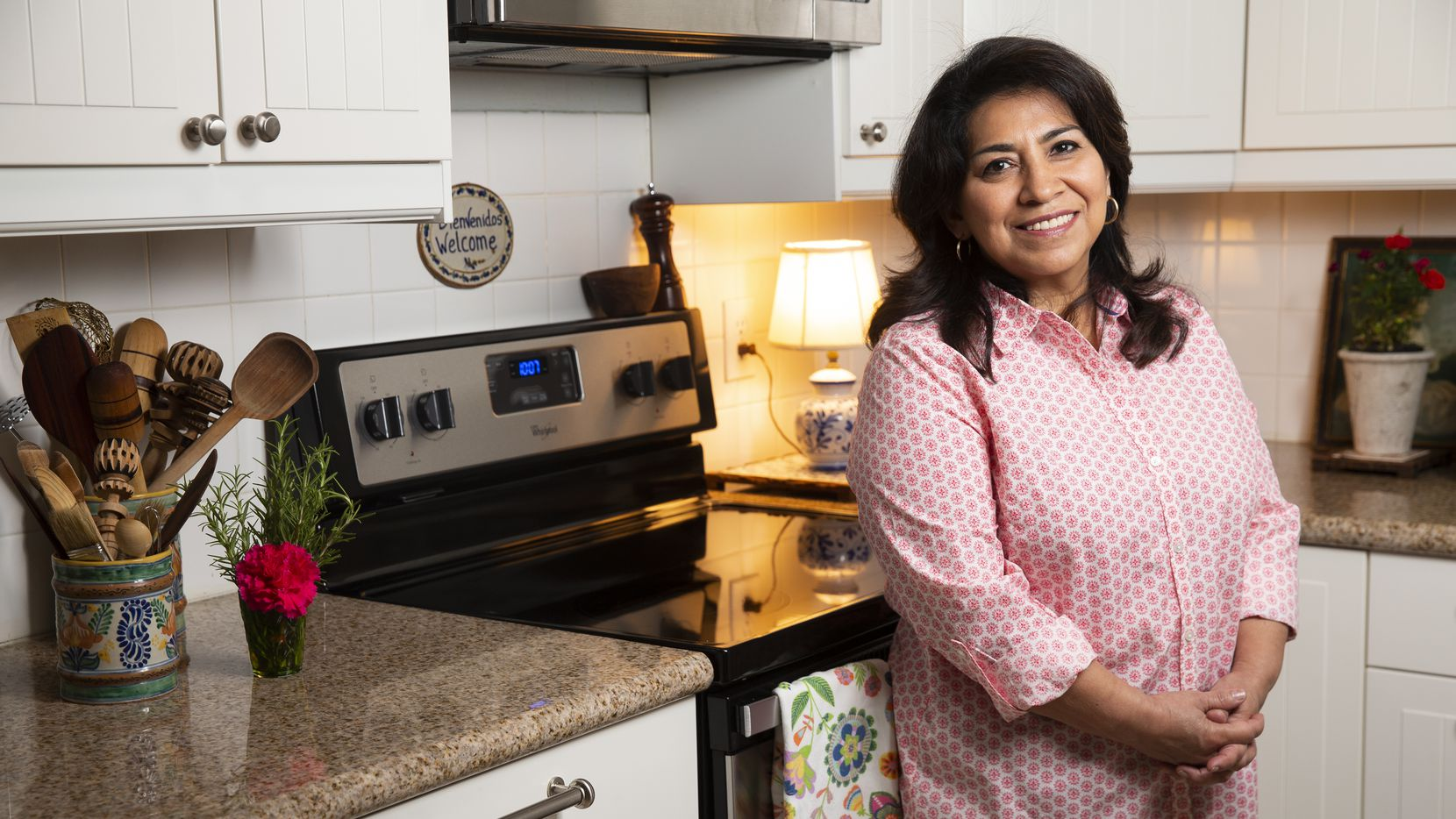 Local author Mely Martínez poses for a photo in her kitchen on Sept. 10, 2020 in Frisco.