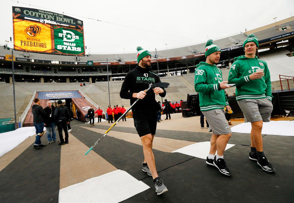 Dallas Stars right wing Alexander Radulov (47), goaltender Anton Khudobin (35) and left wing Roope Hintz (24) get acclimated to the cold weather before their outdoor NHL Winter Classic hockey game with the Nashville Predators at the Cotton Bowl in Dallas, Wednesday, January 1, 2019. (Tom Fox/The Dallas Morning News)