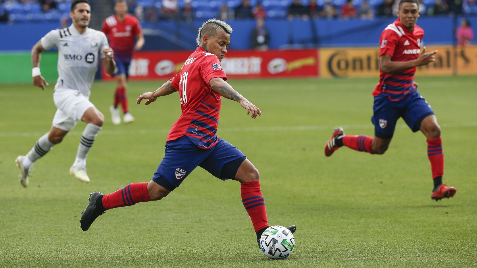 FC Dallas midfielder Michael Barrios (21) makes a run during the first half of an MLS matchup between FC Dallas and Montreal Impact on Saturday, March 7, 2020 at Toyota Stadium in Frisco, Texas.