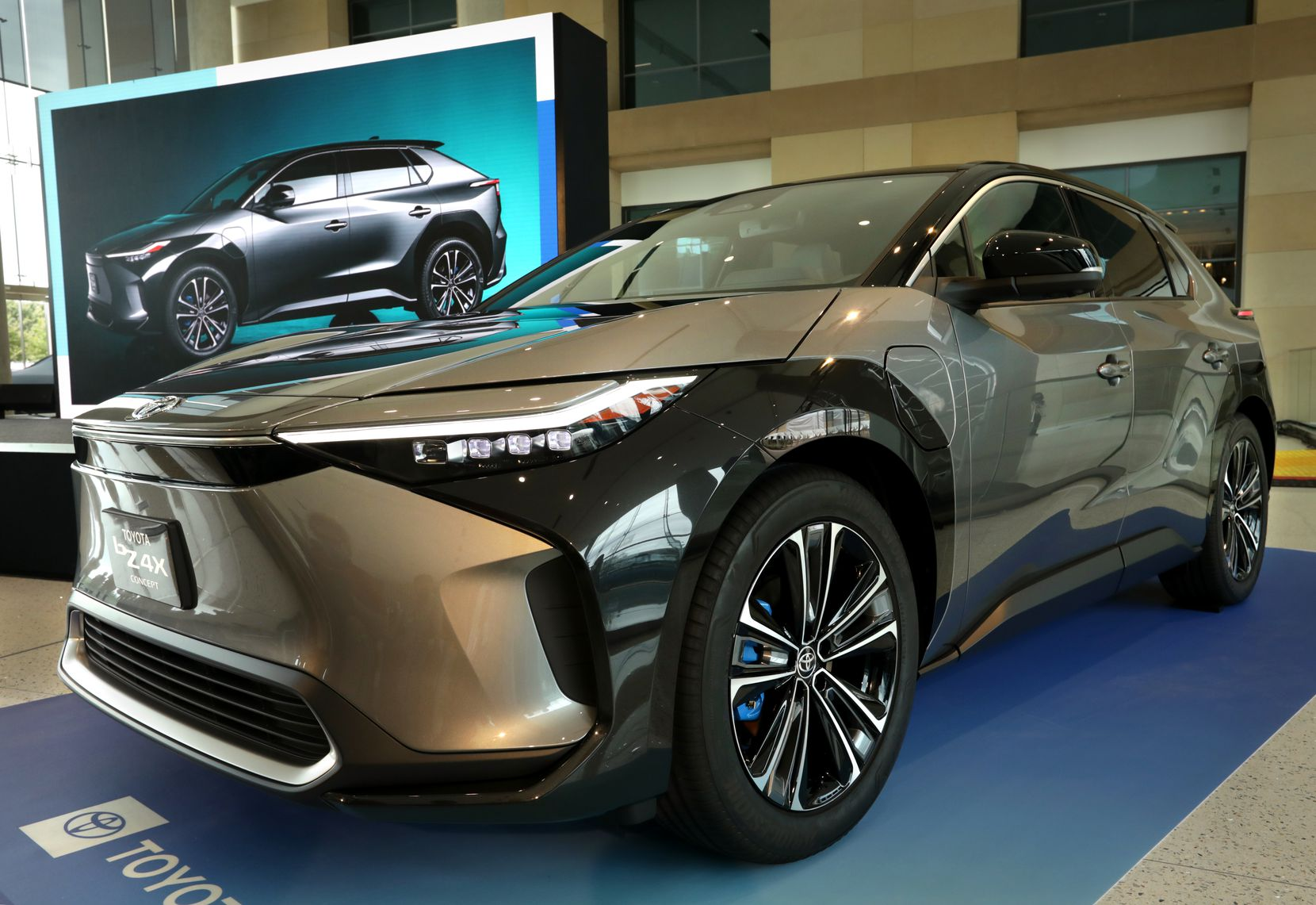 """At an event Wednesday, Toyota touted its new battery electric SUV, the BZ4X, which it plans to release worldwide in mid-2022. BZ, or """"Beyond Zero,"""" will be Toyota's platform for future all-electric vehicles."""