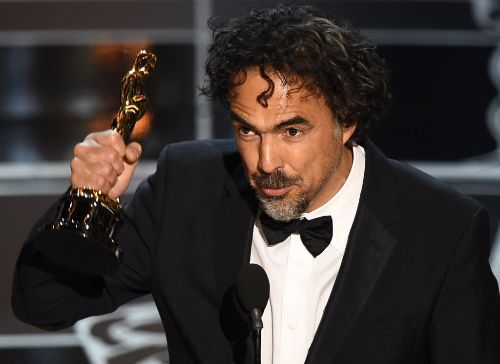 """Winner for Best Director """"Birdman or (The Unexpected Virtue of Ignorance)"""" Alejandro G. Inarritu accepts his award on stage at the 87th Oscars February 22, 2015 in Hollywood, California."""