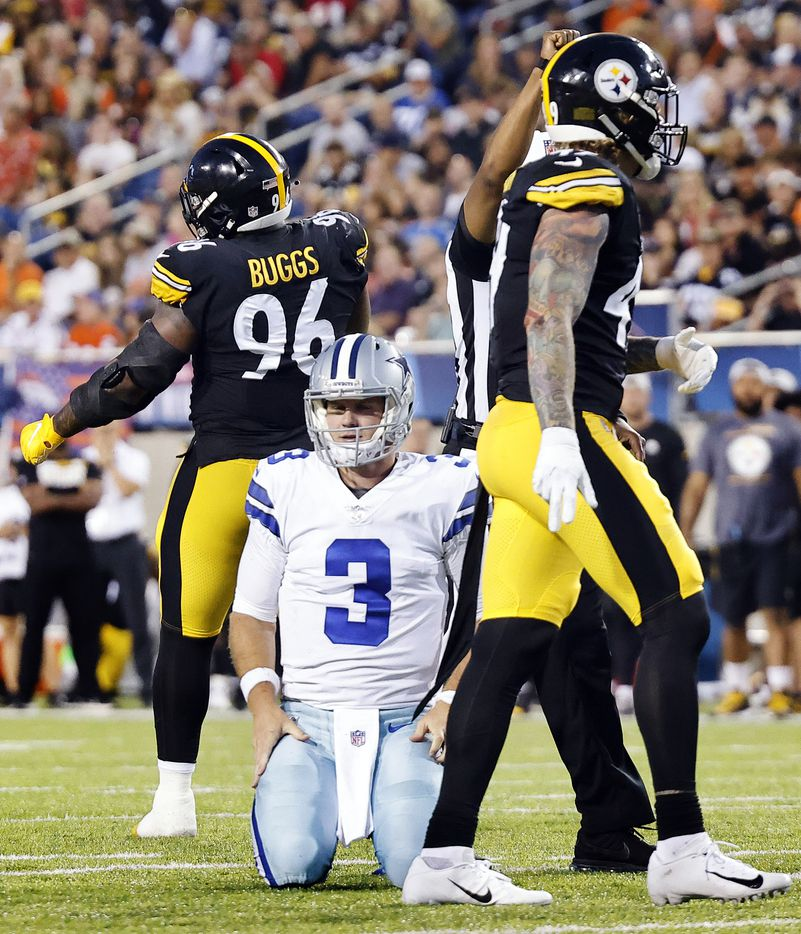 Dallas Cowboys quarterback Garrett Gilbert (3) is slow to get up after being sacked by Pittsburgh Steelers defensive end Isaiahh Buggs (96) during the first half of their preseason game at Tom Benson Hall of Fame Stadium in Canton, Ohio, Thursday, August 5, 2021. (Tom Fox/The Dallas Morning News)