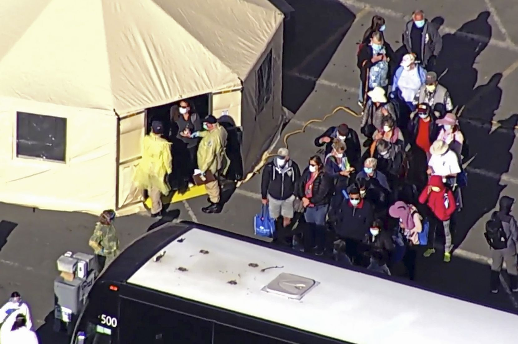 On March 10, passengers waited to board buses after leaving the Grand Princess cruise ship at the Port of Oakland in Oakland, Calif.