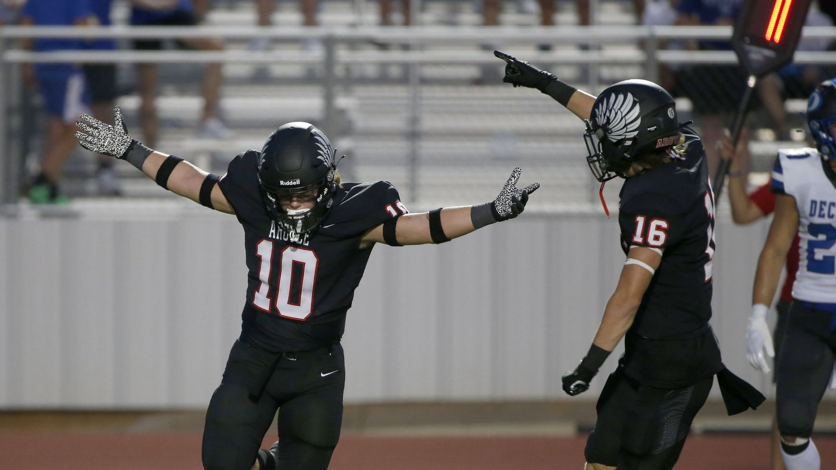 Argyles Will Ramsey (10) celebrates his interception against Decater with Jacob Robinson (16) during a high school football game in Argyle, Tx, on August 28, 2020.