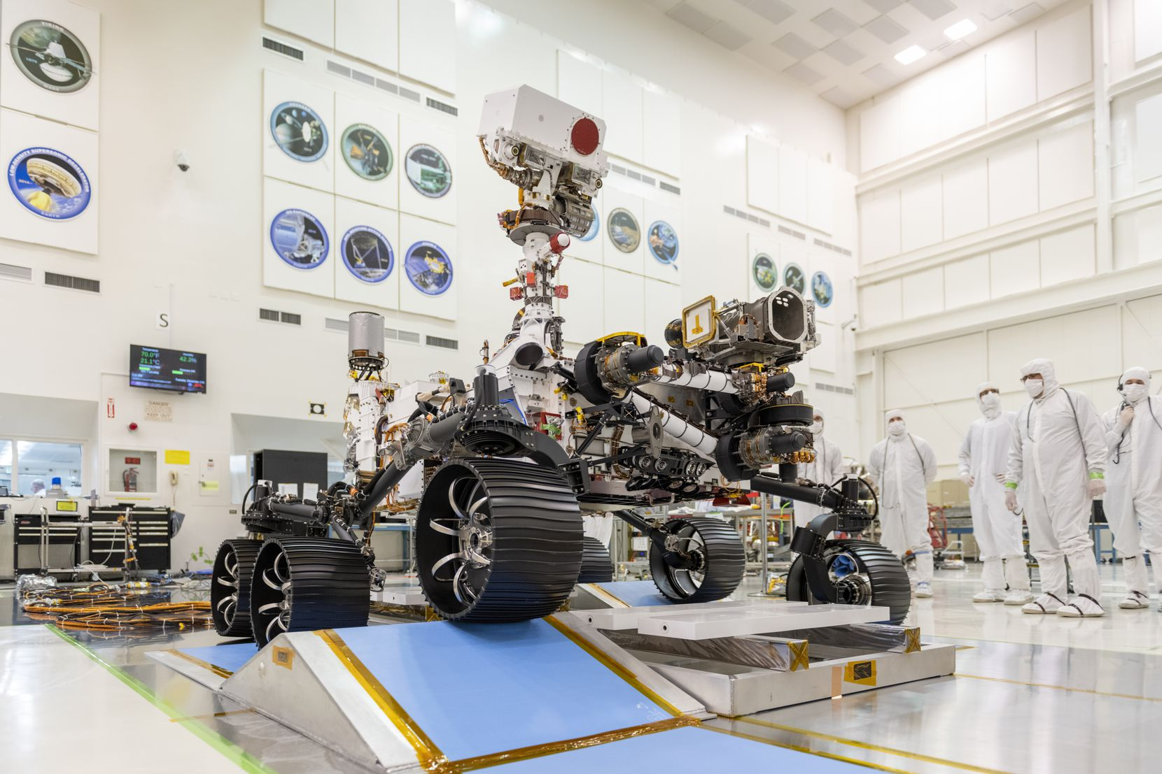 In a clean room at NASA's Jet Propulsion Laboratory in Pasadena, Calif., engineers observed the first driving test for NASA's Mars 2020 Perseverance Rover in 2019. The Rover, which went into space last July, will hunt for signs of past microbial life and collect rock and soil samples using a calibration device designed by Jacobs and the Jet Propulsion Laboratory.