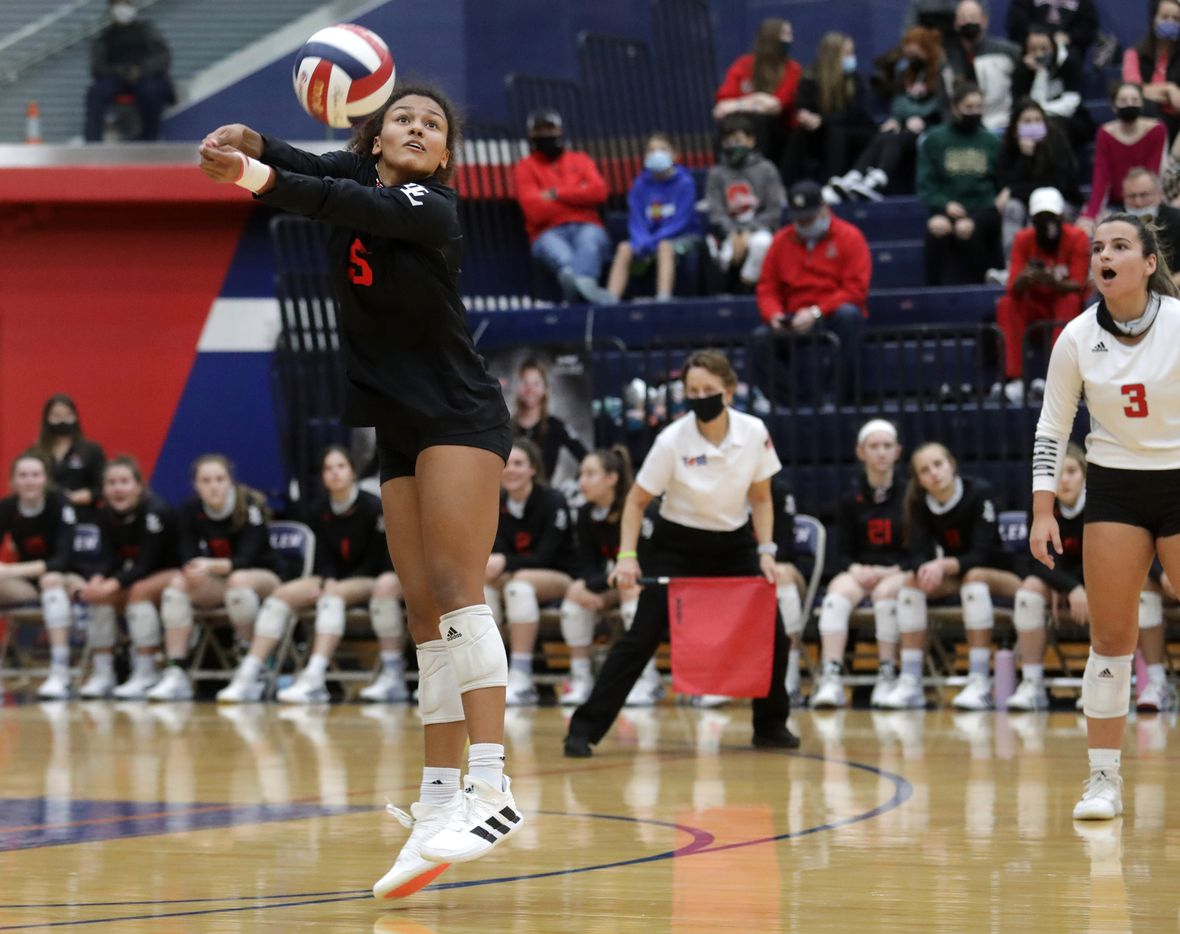 Lovejoy High School player 5, Cecily Bramschreiber, hits the ball during a volleyball playoff match against McKinney North High School at Allen High School in Allen, TX, on Dec. 3, 2020. (Jason Janik/Special Contributor)